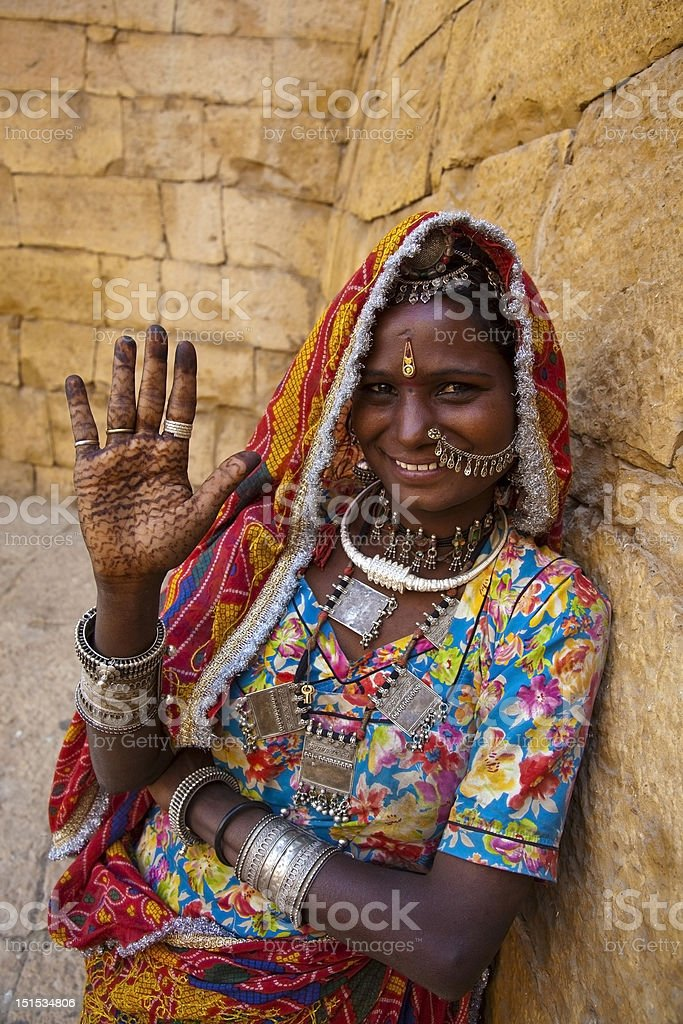 indian woman showing henna painted hand stock photo