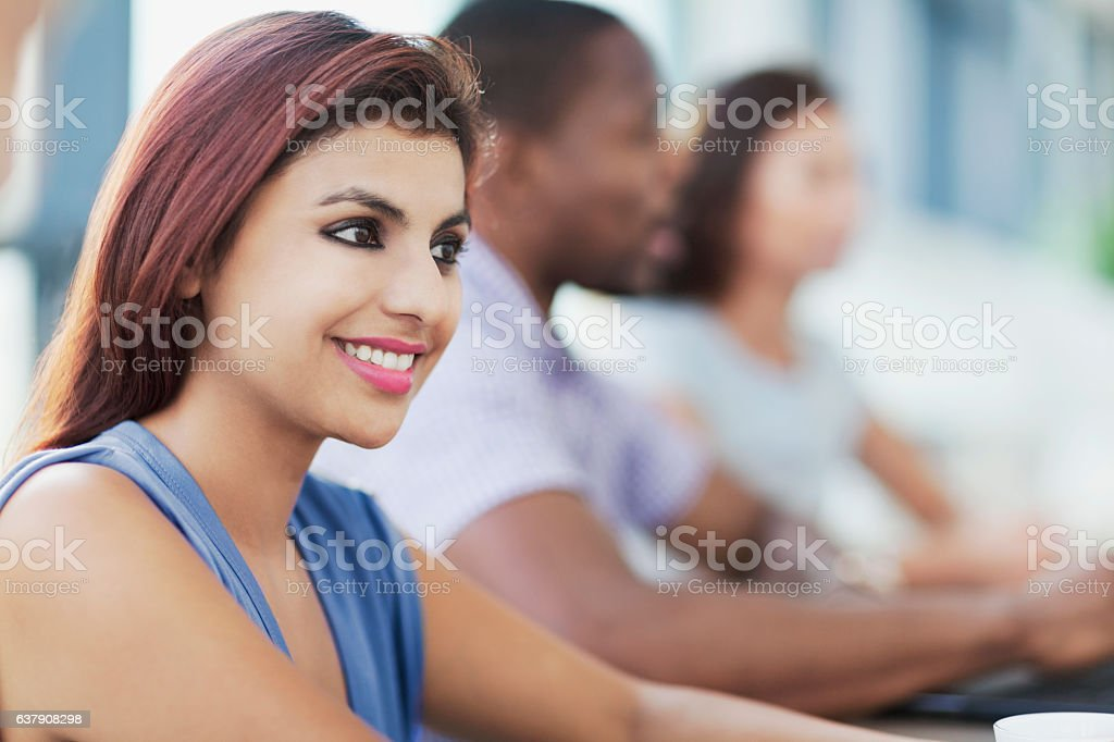 Indian woman smiling in meeting stock photo