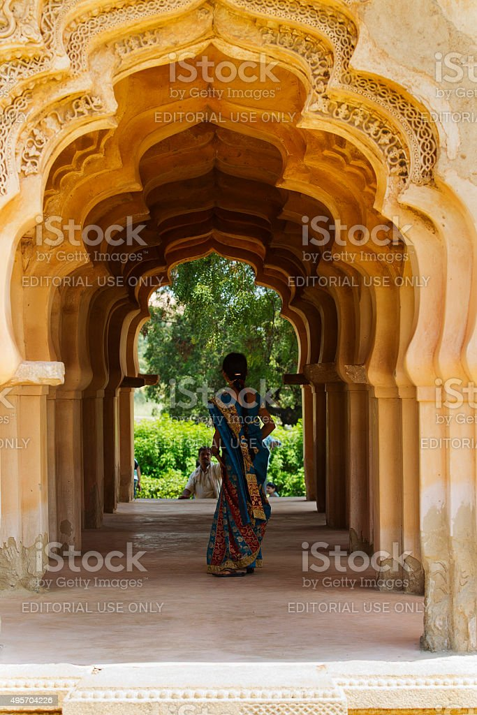 Indian woman walking through a Lotus Mahal corridor in Hampi stock photo