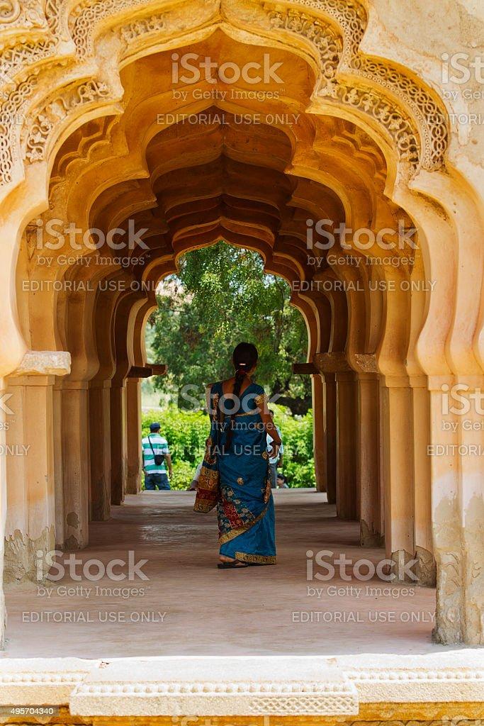 Indian woman walking through a temple corridor stock photo