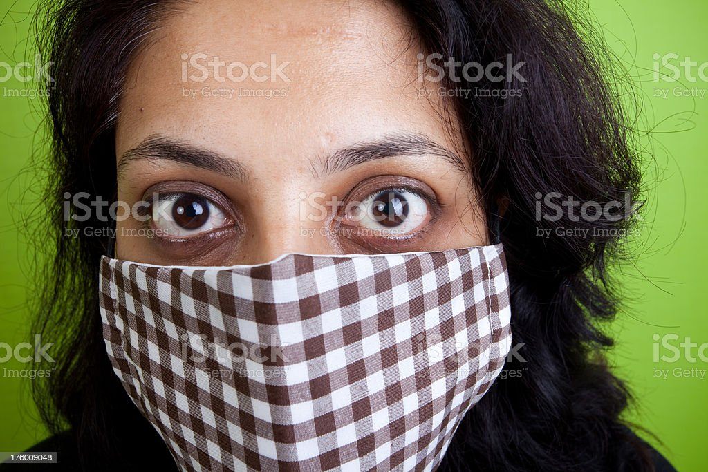 Indian woman wearing a mask against swine Flu royalty-free stock photo