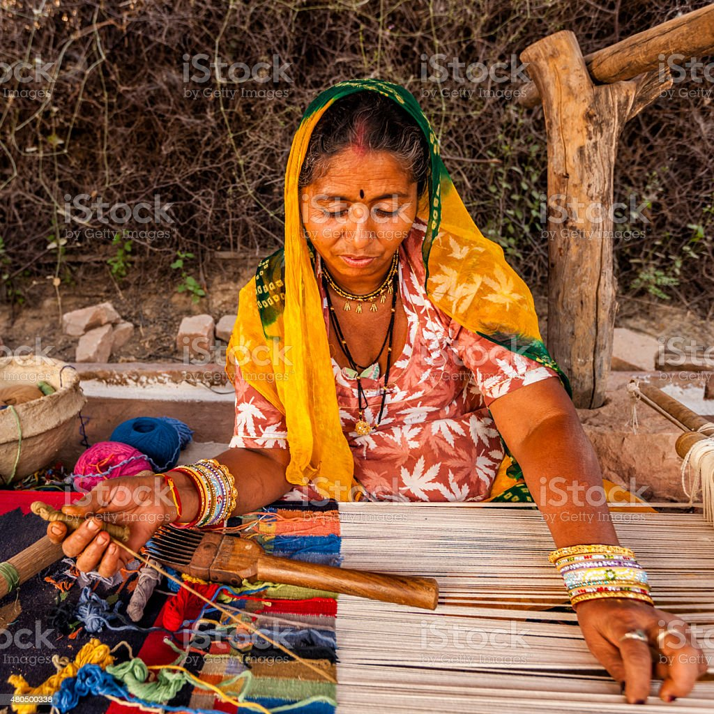 Indian woman weaving textiles (durry) in Rajasthan stock photo