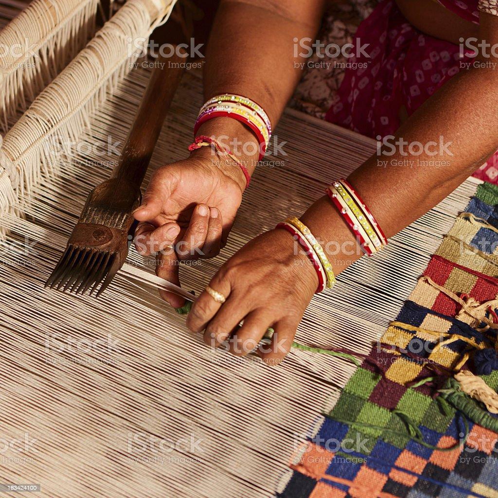 Indian woman weaving textiles (durry). Salawas village. Rajastha stock photo