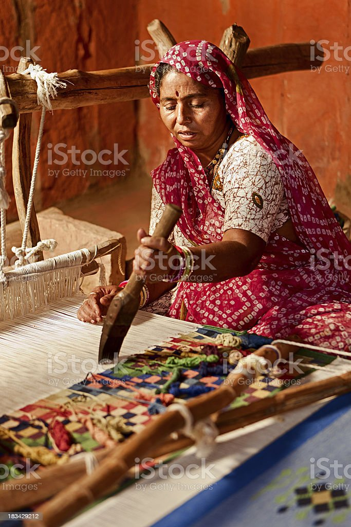 Indian woman weaving textiles (durry). Salawas village. Rajastha royalty-free stock photo