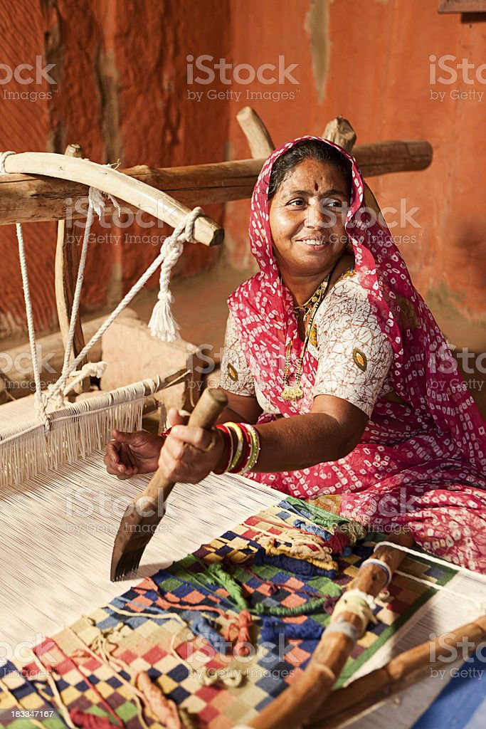 Indian woman weaving textiles (durry). Salawas village. Rajasthan. royalty-free stock photo