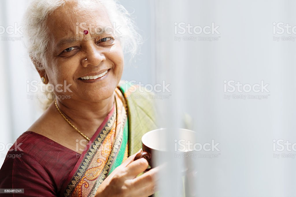 Indian woman with a mug stock photo