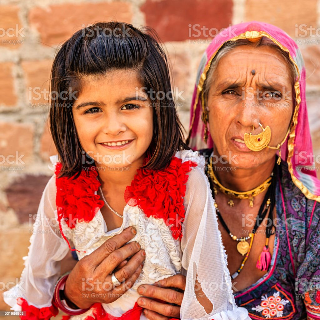Indian woman with her granddaughter, Bishnoi village stock photo