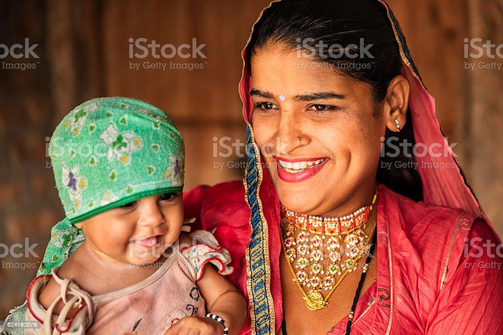 Indian woman with her newborn daughter, Bishnoi village stock photo