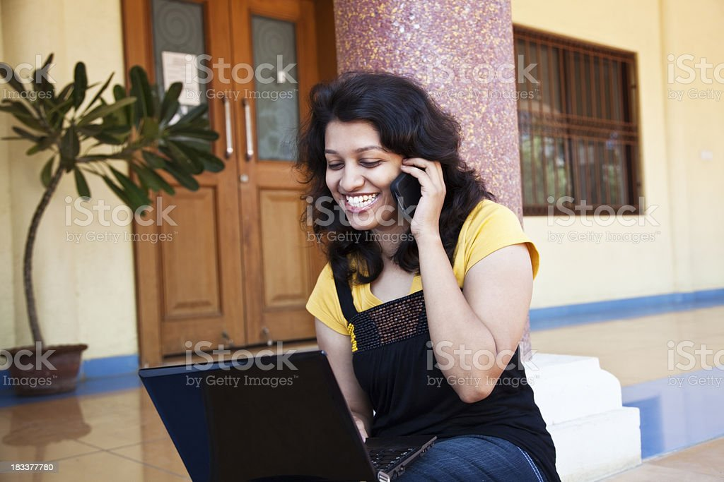 indian woman with laptop and cellphone royalty-free stock photo