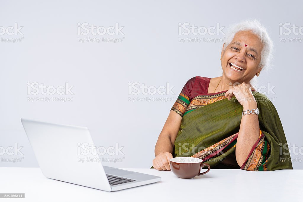 Indian woman with laptop stock photo