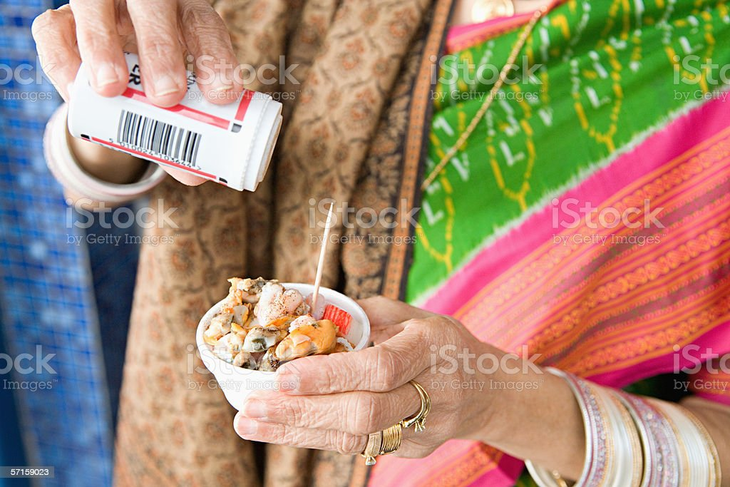 Indian woman with pot of seafood royalty-free stock photo