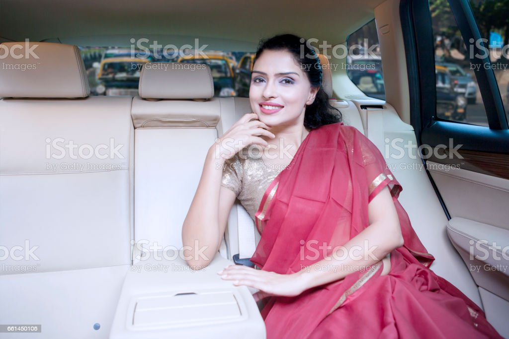 Indian woman with saree clothes in car stock photo