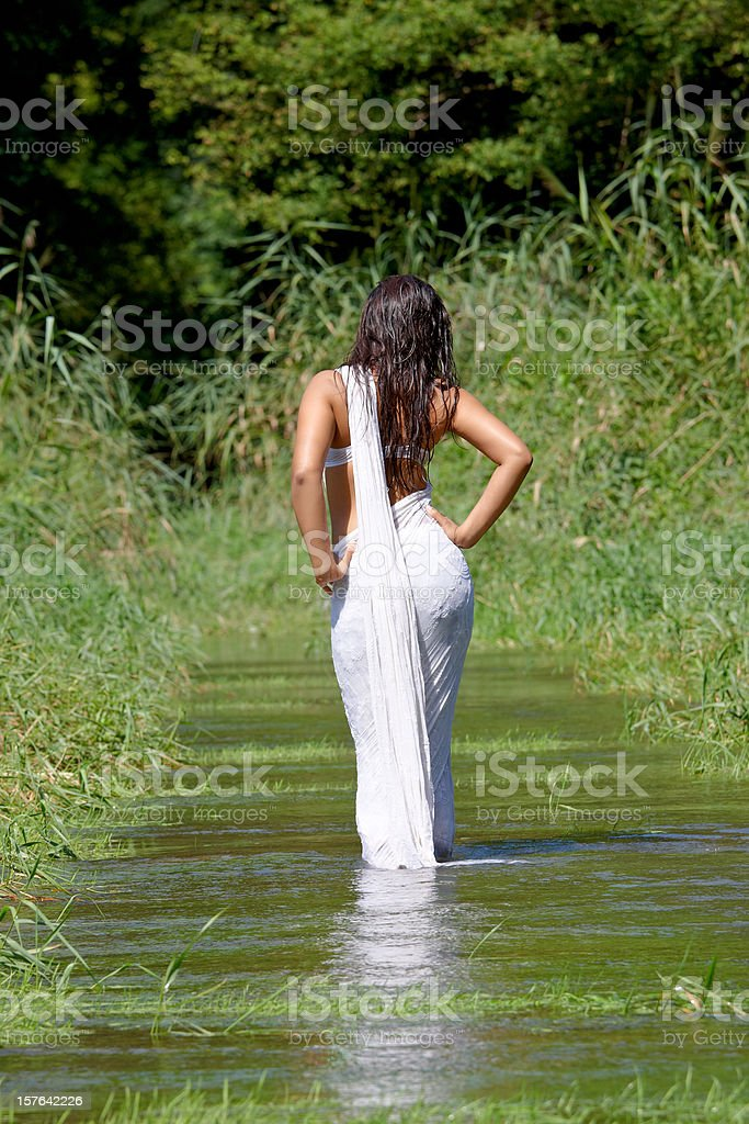 indian woman with sari in the water royalty-free stock photo
