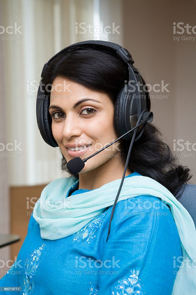 Indian woman working in a call centre royalty-free stock photo