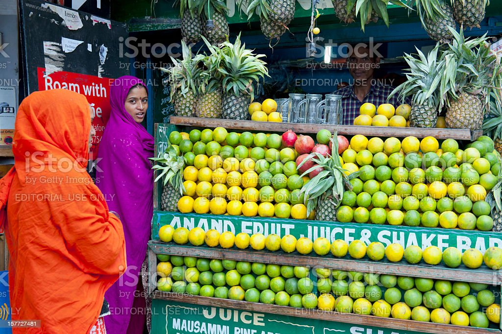 Indian Women Buying Tropical Fruit Juice stock photo