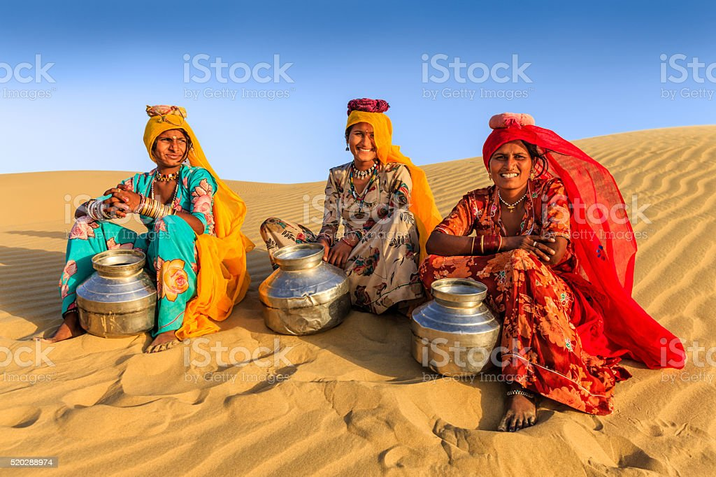 Indian women carrying water from local well, desert village, India stock photo