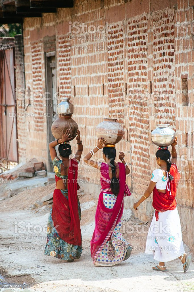 Indian women carrying water on head stock photo