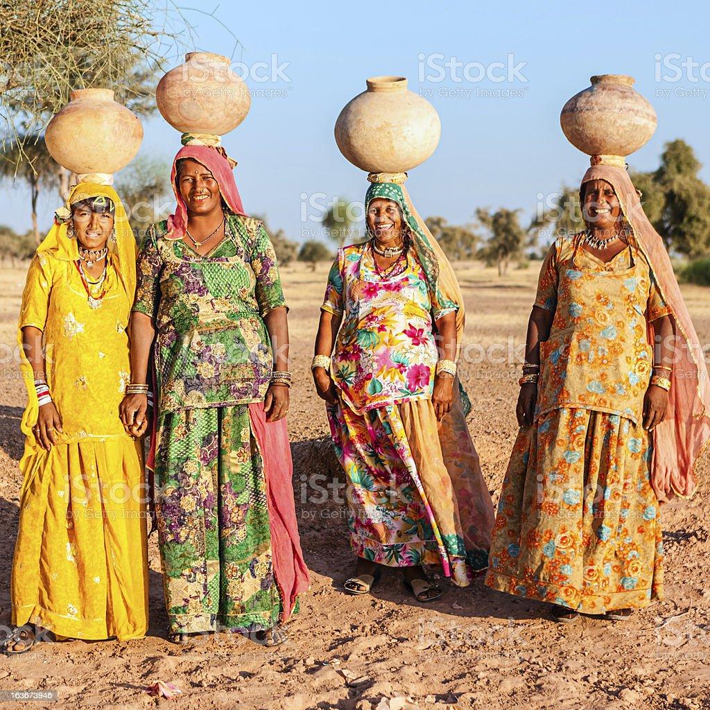 Indian women carrying water, Rajasthan royalty-free stock photo