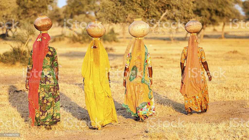 Indian women carrying water, Rajasthan royalty-free stock photo