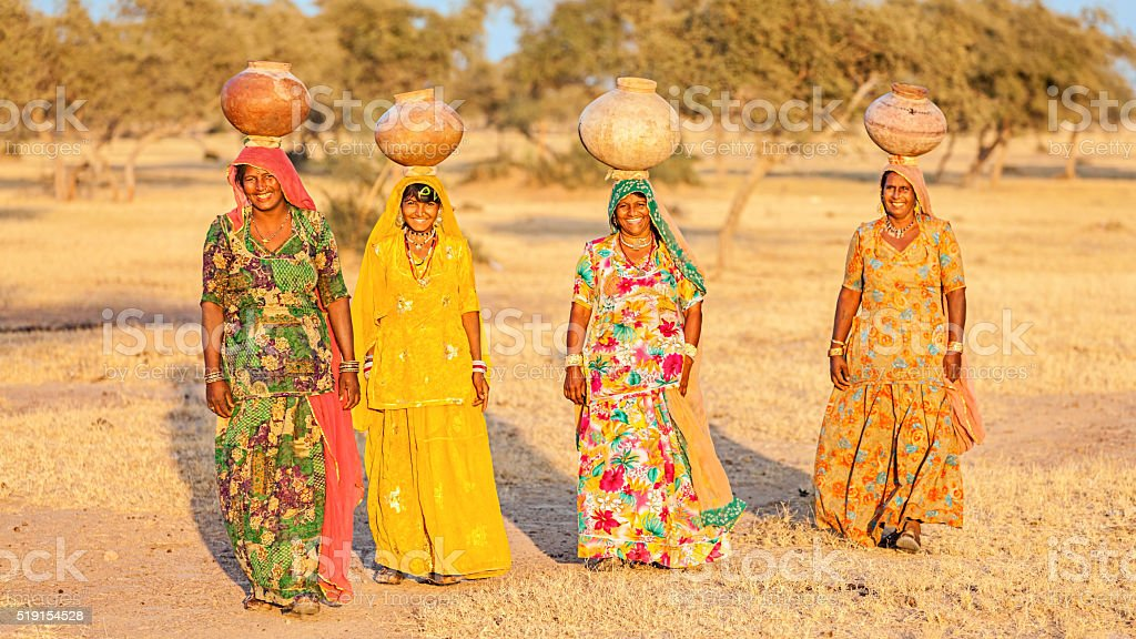 Indian women carrying water, Rajasthan stock photo