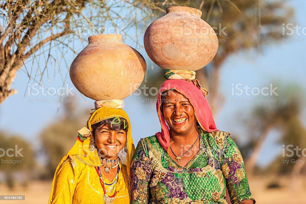 Indian women carrying water, Rajasthan stock photo