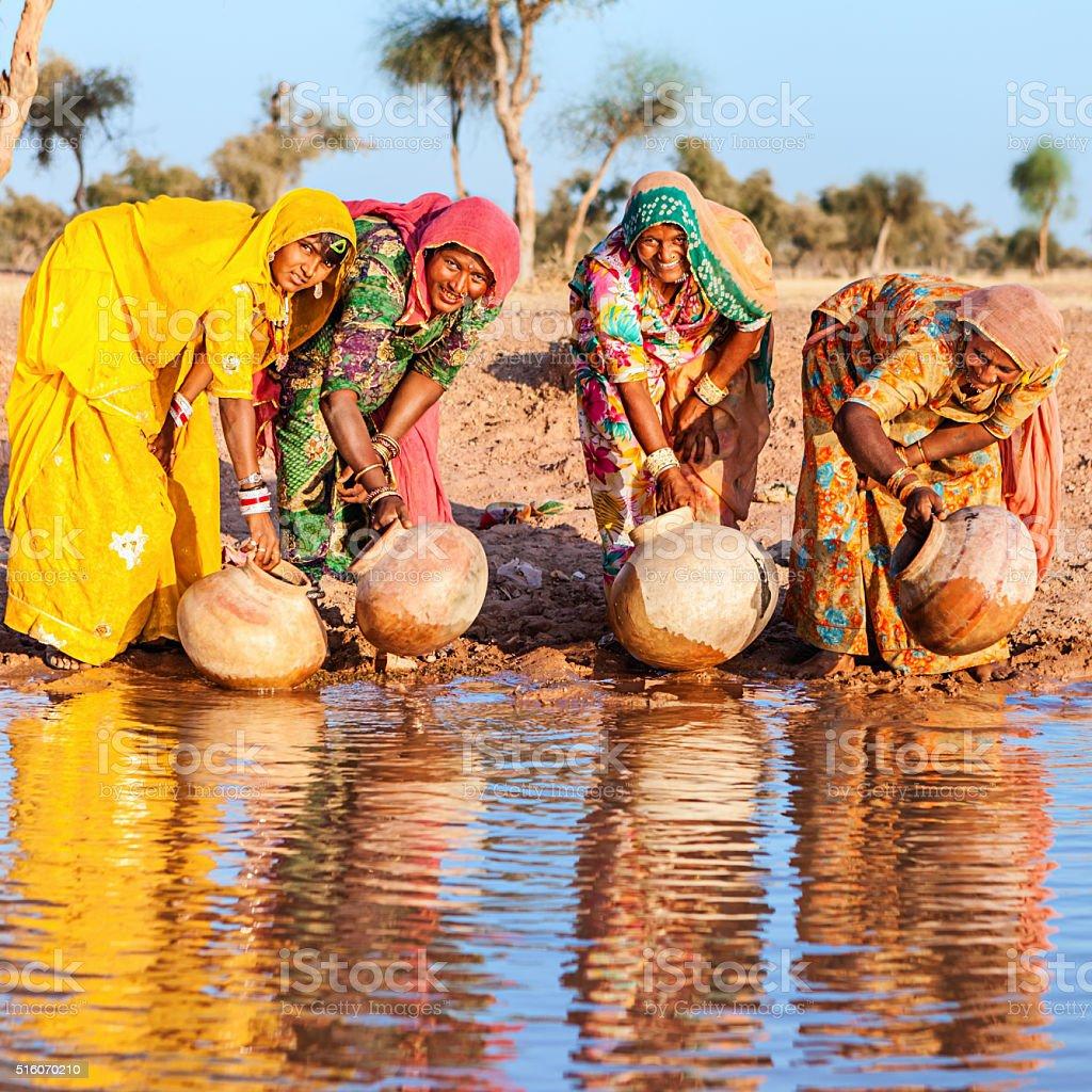 Indian women collecting water on Thar Desert, Rajasthan stock photo