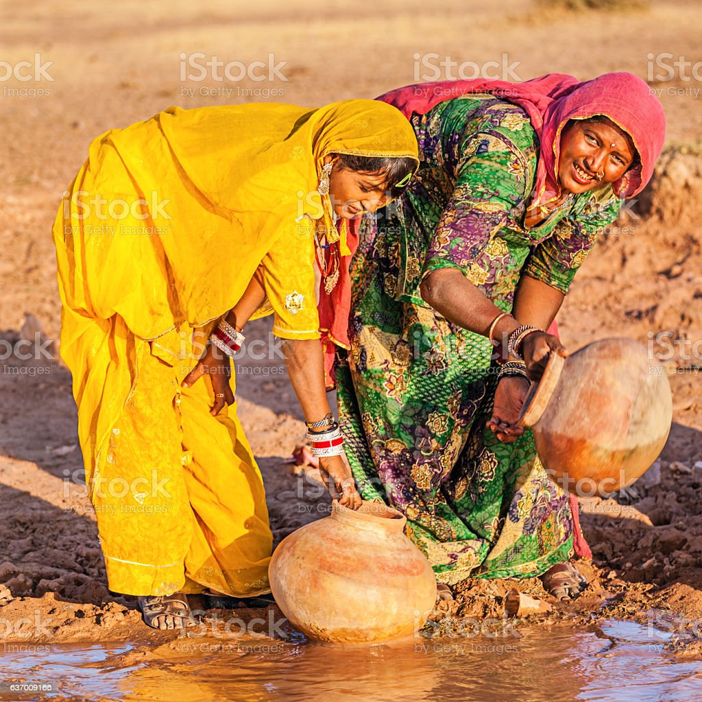 Indian women collecting water, Rajasthan stock photo