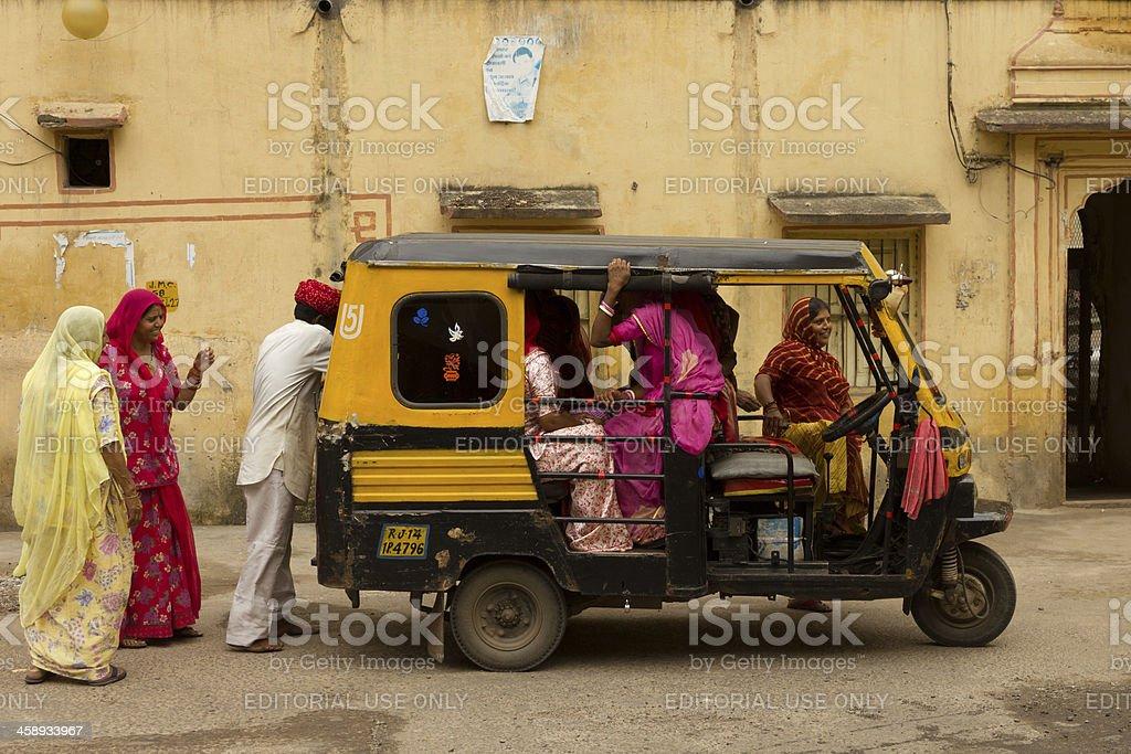 Indian women getting into a rickshaw stock photo