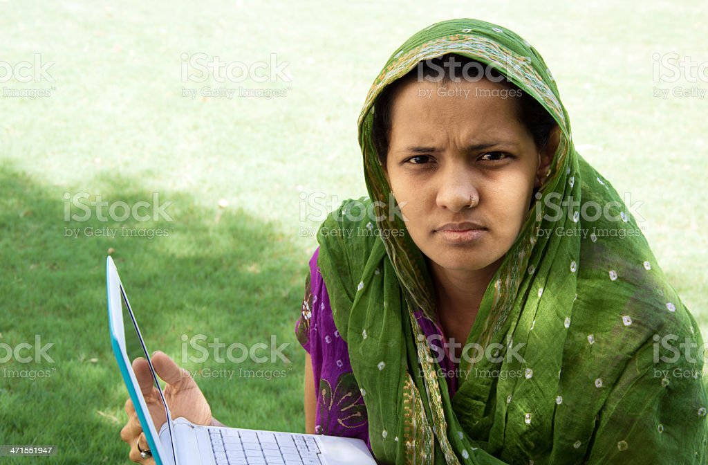 Indian women Holding laptop in the park royalty-free stock photo