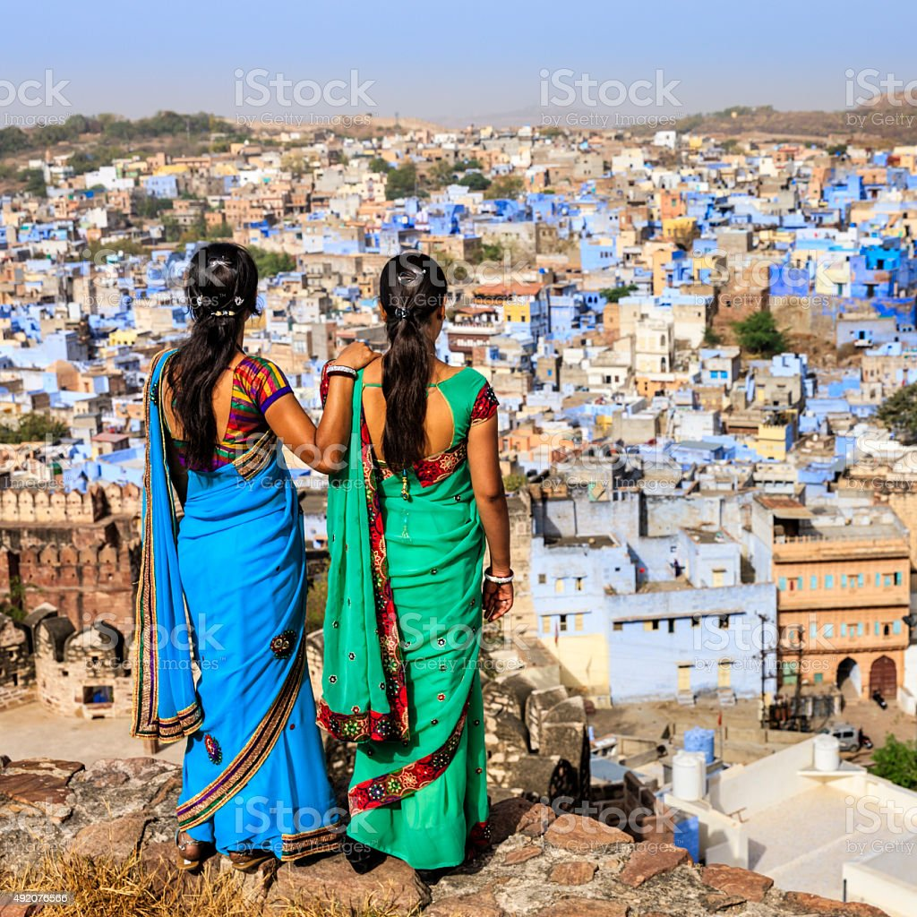 Indian women looking at the Blue City of Jodhpur, India stock photo