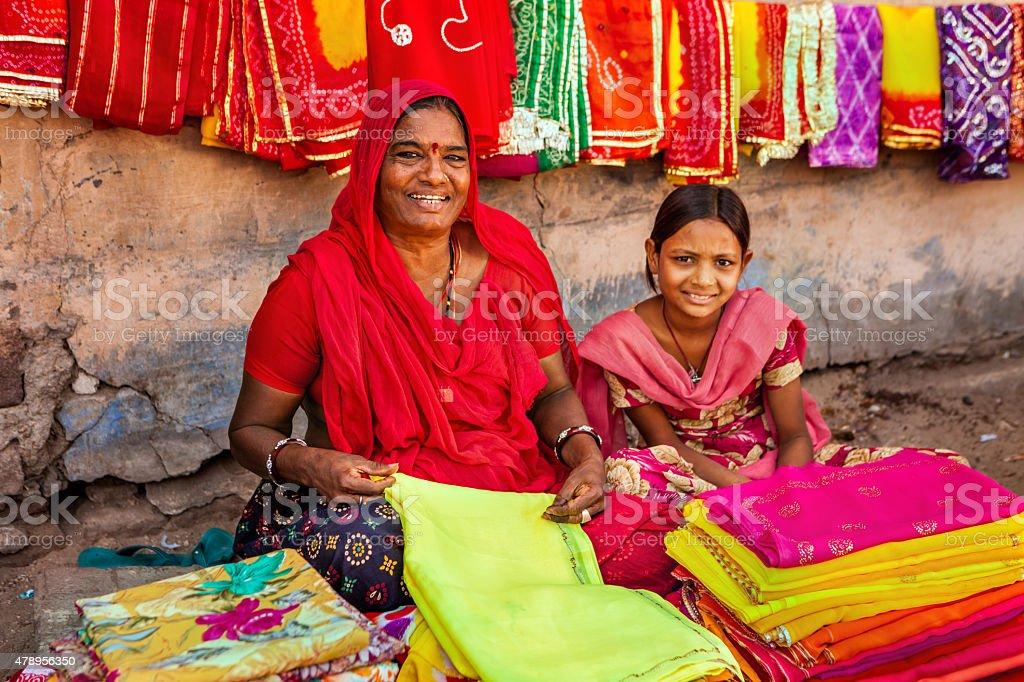 Indian women selling colorful fabrics stock photo