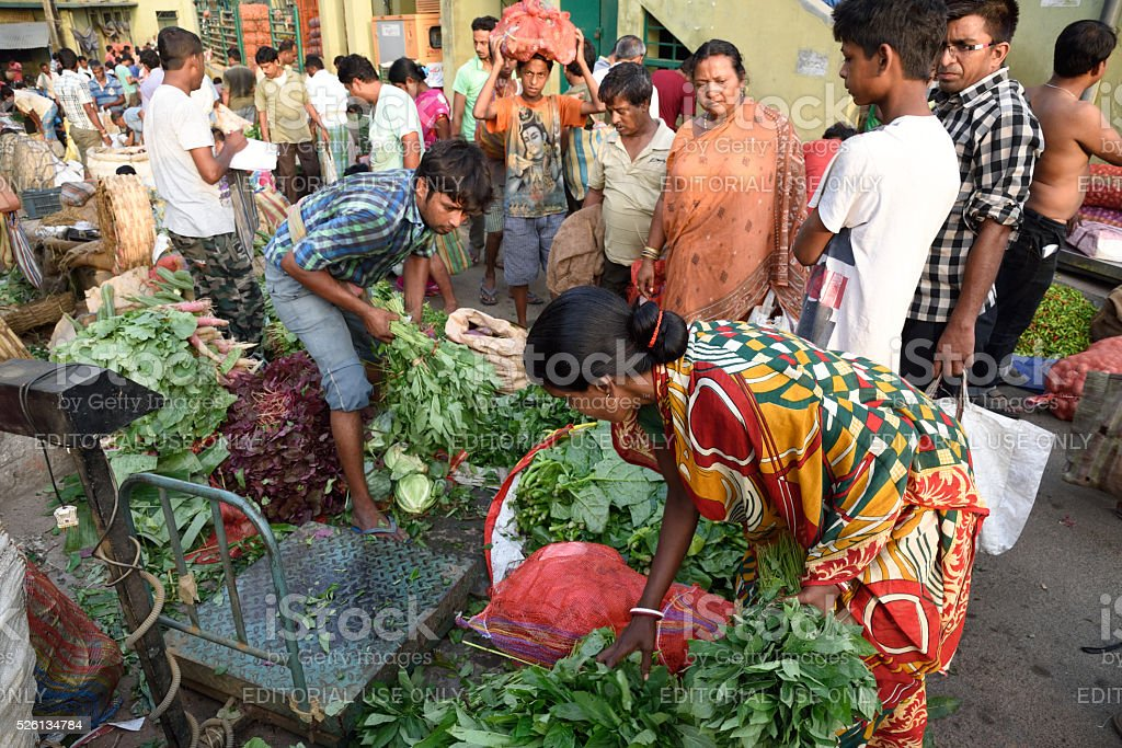 Indian women selling vegetables in Market stock photo