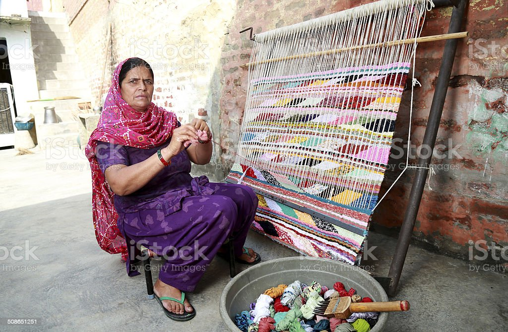 Indian Women Weaving Textile (durry) . royalty-free stock photo