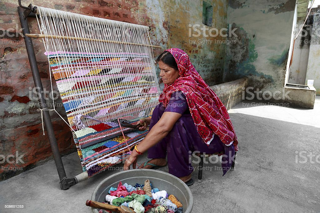Indian Women Weaving Textile (durry) . stock photo
