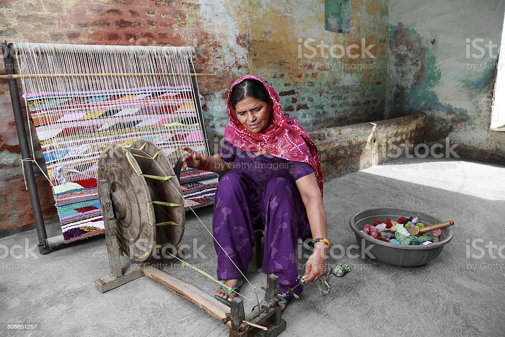 Indian Women Weaving Textile (durry). stock photo