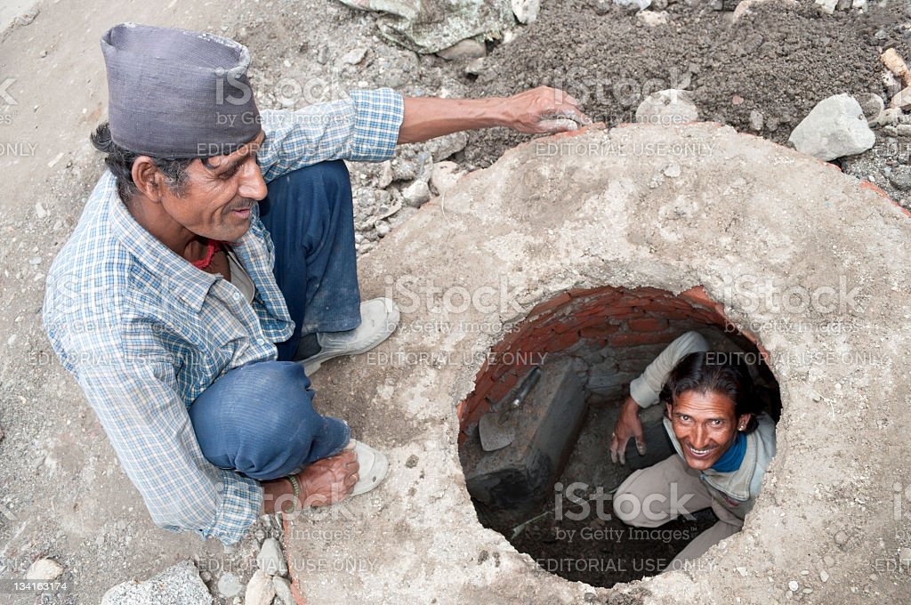 Indian Workers in Drain Manali royalty-free stock photo