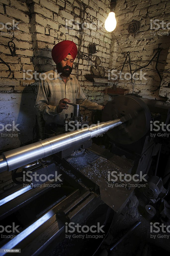 Indian workers: lathe operator royalty-free stock photo