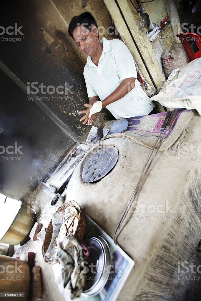Indian workers: making naan bread stock photo