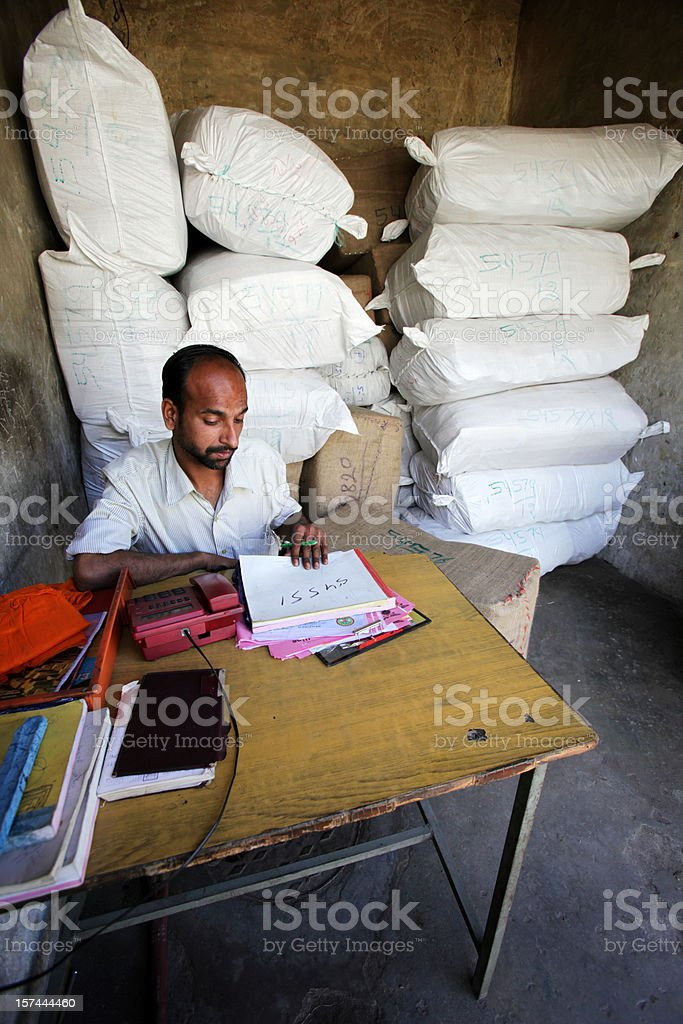 Indian workers: warehouse management stock photo