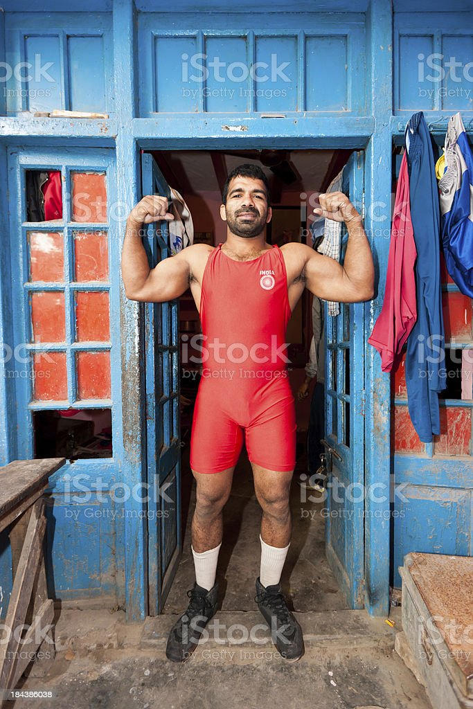 Indian Wrestler Posing at Entrance Door New Delhi India stock photo