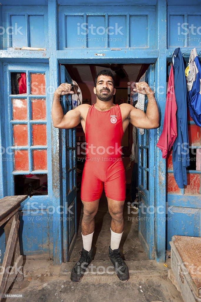 Indian Wrestler Posing at Entrance Door New Delhi India stock photo