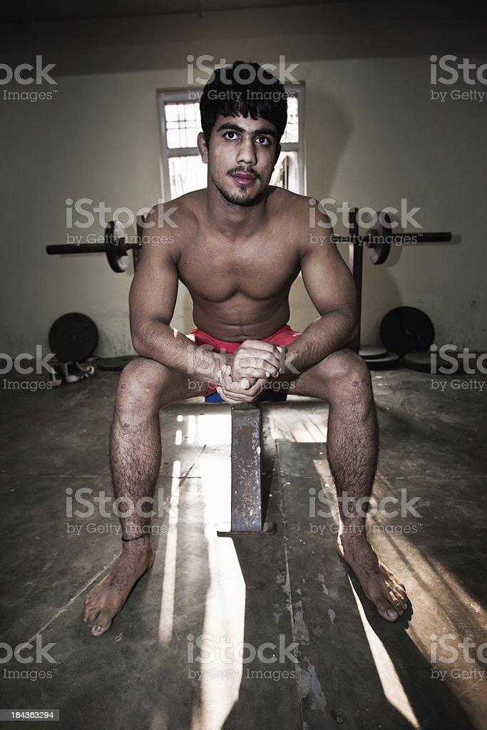 Indian Wrestler Sitting on Weight Bench New Delhi India stock photo