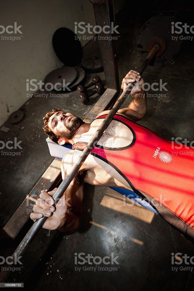 Indian Wrestler Training on Weightbench New Delhi India stock photo