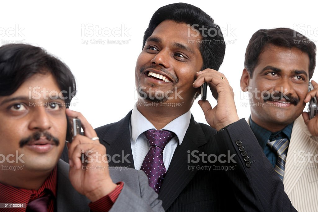 Indian young business peoples talking in mobile stock photo