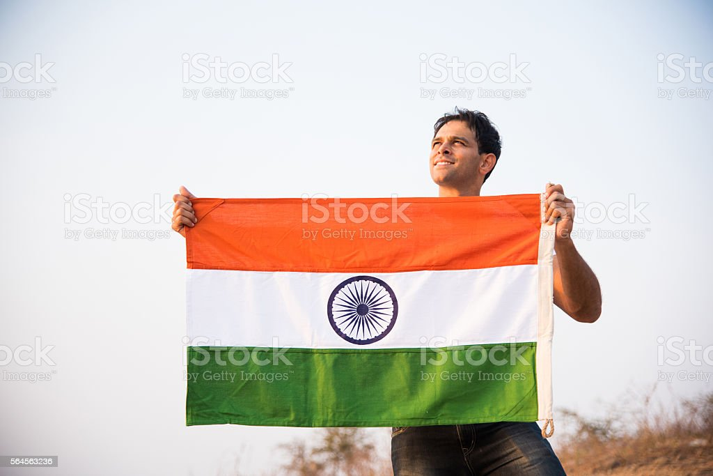 indian young man waving indian flag stock photo