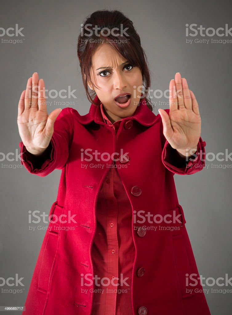Indian young woman making stop gesture sign from both hands