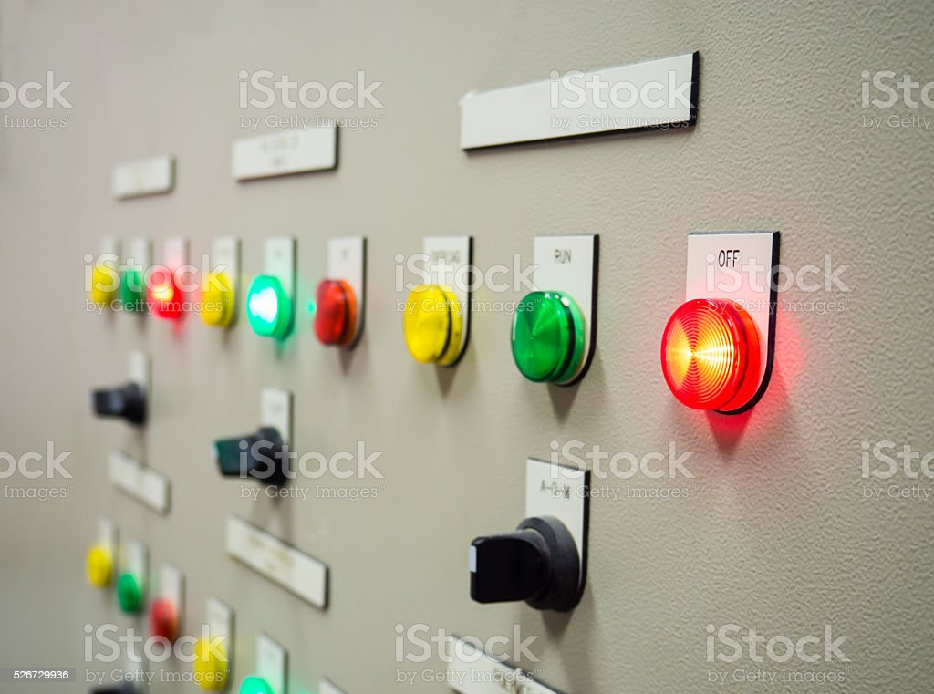 Indicator light and selective switch on electrical control panel. stock photo