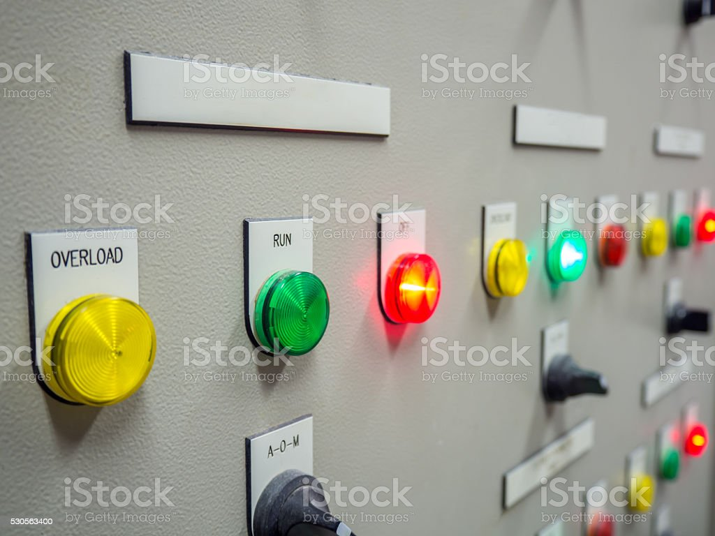 Indicator light on electrical control panel with blank name tag. stock photo