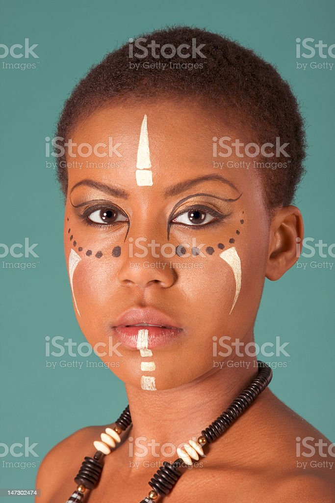 indigenous Afro American woman in tribal facepaint royalty-free stock photo