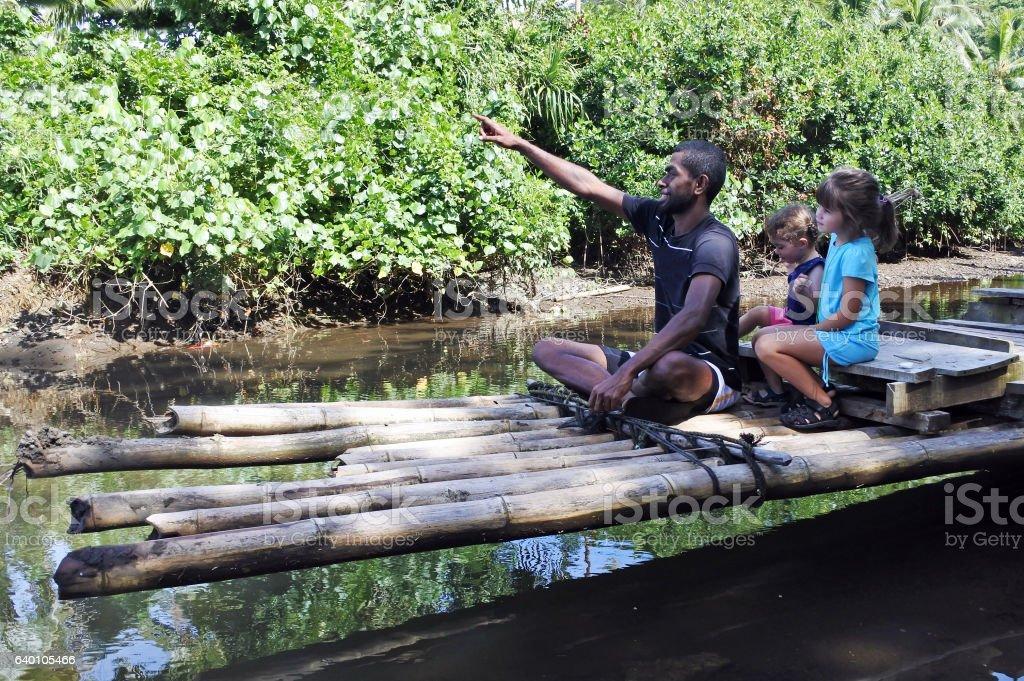 Indigenous Fijian man building traditional bamboo boat stock photo
